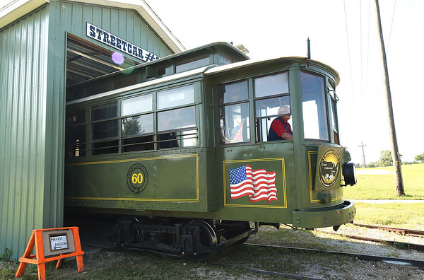 Street Car No. 60 is pushed out of its barn by a new switch engine last week at King Jack Park in Webb City. The trolley recently received the new engine courtesy of Rick Webb of Watco.<br /> Globe | Laurie SIsk