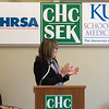 Nancy Rios, deputy regional administrator with HRSA Office of Regional Operations, leads a round of applause after announcing a grant for rural residency program on Thursday at the Community Health Center of Southeast Kansas.<br /> Globe | Roger Nomer