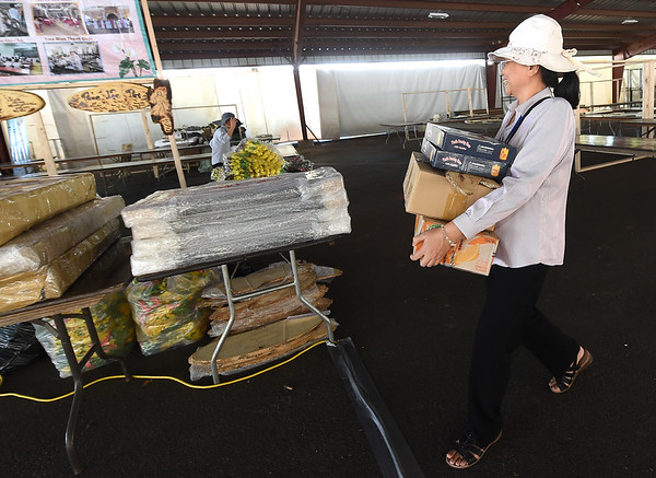 Sister Nguyen Thi Mai Duyen carries supplies as she sets up a stand of faith-based craft items on Tuesday at at Carthage's Congregation of the Mother of the Redeemer. The annual MArian Days opens Thursday at the church campus.<br /> Globe | Laurie Sisk