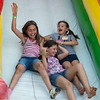 (from left) Autumn Brockitt, 9, and sisters Kylee and Kelcey Moore, both 10, go down a slide before the fireworks at Missouri Southern on Thursday.<br /> Globe | Roger Nomer