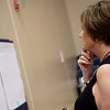 Cathy Jo Loy looks at options for facility improvements during a community forum on Tuesday at West Central Elementary.<br /> Globe | Roger Nomer