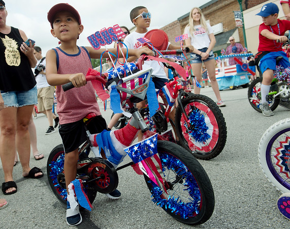 Brothers Camden, 4, and Garyn Colbert, 9, prepare to ride in the Fourth of July parade in Carl Junction on Thursday.<br /> Globe | Roger Nomer
