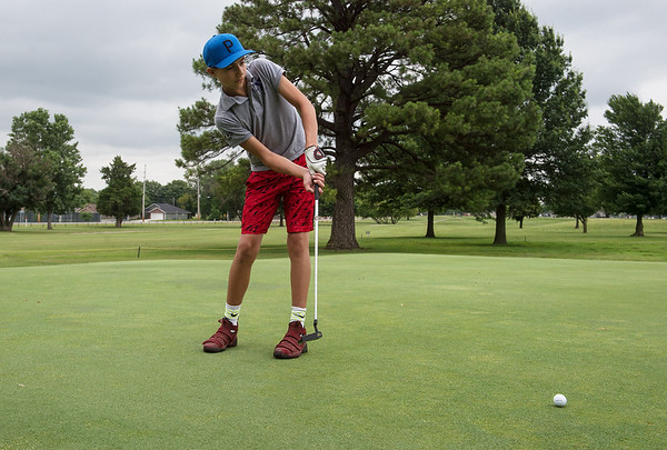 Tyler Campbell, 13, Neosho, putts at Schifferdecker Golf Course on Wednesday.<br /> Globe | Roger Nomer