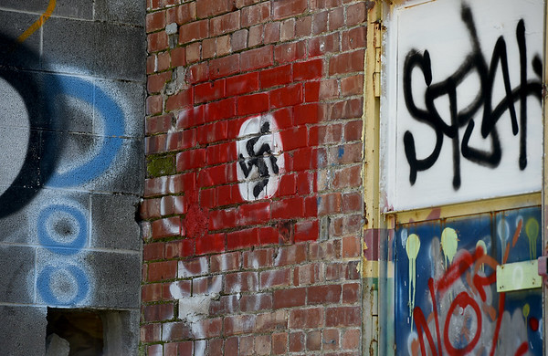 A swastika is spray painted on the back dock of the former Kansas Gas and Electric Headquarters in Pittsburg. The city has experienced an increase in graffiti recently.<br /> Globe | Laurie Sisk