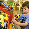 Three-year-old Alex Mitchell checks out the selection of brightly colored fountains as he shops for fireworks on Wednesday at Grandpa's Black Market Fireworks on North Main Street. The store is open through Saturday for the holiday weekend.<br /> Globe | Laurie Sisk