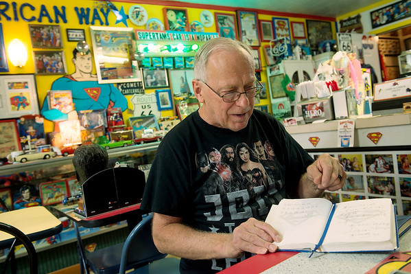 Supertam owner Larry Tamminen talks about a book that Chinese visitors sign as they travel on Route 66 during an interview on June 21.<br /> Globe | Roger Nomer