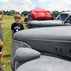 From the left: Dylan Johnson, 9 and Caden Mahurin, 10, both of Webb City, check out a duo of antique Chevrolets on exhibit by Brookman's Muffler during the Webb City Route 66 Cruise-A-Palooza & Outdoor Expo at King Jack Park on Saturday. The event also featured a car show, craft vendors, a sidewalk sale and carnival rides.<br /> Globe | Laurie Sisk