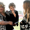 From the left: On Tuesday, Sarah Burton's mother, Stephanie Burton holds her granddaughter, Annalise Midyett, 2, as Amanda Midyett, Annalise's mother and Sarah's sister, looks on during a vigil at Mercy Park for Sarah, who was last seen on July 16, 2018, near 10th Street and Rex Avenue. <br /> Globe | Laurie Sisk