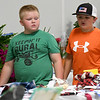 From the left: Mack Thogmartin, 7, of Neosho and Jeffery Todd, 10, of Seneca, check out the exhibits in the exhibition hall on Thursday at the Newton County Fair in Neosho.<br /> Globe | Laurie Sisk