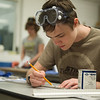 Gavin Hobart, 16, plans a draft during Camp AMPED on Wednesday at Crowder College in Neosho.<br /> Globe | Roger Nomer