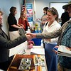 BEN GARVER — THE BERKSHIRE EAGLE<br /> Melissa O'Brien, a human resources officer for Interprint shakes hands with Andrew Kingafter discussing and internship. <br /> MassHire Berkshire Career Center at 160 North Street held an advanced manufacturing job fair in Pittsfield for job seekers who have taken their advanced manufacturing training or who have an interest in the field.