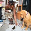 BEN GARVER — THE BERKSHIRE EAGLE<br /> Veronica Horne feeds her baby duck Abeja (the Spanish word for bee) outside of Fuel in Great Barrington in the company of her dog Wendell, Wednesday, June 19, 2019.  Horne raises ducks and Abeja uas an injured foot, so he (or she) gets special care.