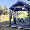 HEATHER BELLOW - THE BERKSHIRE EAGLE <br /> Susan Baxter at the completed Thoreau Pipeline Barricade Cabin on her property that abuts the company easement.