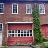 HEATHER BELLOW – THE BERKSHIRE EAGLE<br /> The former Cook's Garage mill complex in Housatonic is in the process of being taken by the town for back taxes.