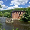 HEATHER BELLOW – THE BERKSHIRE EAGLE<br /> The former mill building known as Cook's Garage, as seen from across the Housatonic River in Housatonic Village.