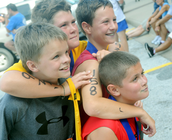 Globe/Roger Nomer<br /> (from left) Lance Ward, 10, Joe Kennedy, 12, Nakoa Warren, 11, and Spencer King, 11, pose for a post-race picture at the finish line of the Big Time Youth Triathlon.
