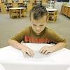 Globe/Roger Nomer<br /> Jozsef Pal, going into fifth grade, works on a laptop during summer school at Cecil Floyd Elementary on Friday.