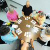 Globe/T. Rob Brown A Joplin family, clockwise from below, Tom Cowen and his wife Fern Cowen, Kay Smither, Bob Cowen, the men's sister Linda Jones and Bob Cowen's wife, Jean Cowen, play a card game called Golf Monday afternoon, June 25, 2012, at the Joplin Senior Center, 22nd Street and Jackson Avenue. The center is extending afternoon hours as a cooling location to give seniors an air-conditioned location during peak heat hours.