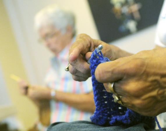 Globe/Roger Nomer<br /> Marie Zeltner, Webb City, left, and Nancy Carlson, Webb City, work on projects for Hope Through Yarn at Central United Methodist Church in Webb City on Saturday morning.  The club meets on the fourth Saturday of every month to work on creations for organizations from Golden Paws to comfort shawls for organ donor families at Freeman Hospital.