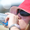 Globe/T. Rob Brown Volunteer Shelbey Lawrence, 16, of Belleville, Ill., pauses from moving tornado debris to hydrate in Monday afternoon's scorching 100 degrees, according to the Weather Channel's website, June 25, 2012. Lawrence and the rest of a youth group from Christ Church, a United Methodist church from Fairview Heights, Ill., were removing rocks and other debris from lots near the intersection of West 26th Street and Joplin Avenue.