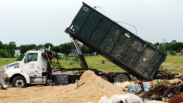 Globe/T. Rob Brown<br /> A truck operator drops off a load of debris Friday afternoon, June 1, 2012, at the Galena, Kan., landfill.
