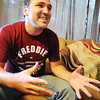 Globe/T. Rob Brown Freddie Jennings, of Goodman, reflects Thursday morning, June 21, 2012, at his mother's home, on the past year as he fought to recover from a near-fatal head injury while in China.
