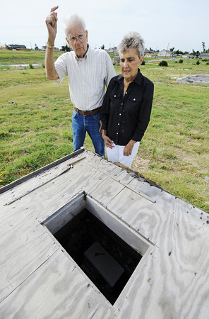 Globe/T. Rob Brown Don and Shirley Conner stand Wednesday morning, June 12, 2012, near their former home in the 2300 block of Missouri Avenue as they talk about the events of May 22, 2011. The couple rode out the storm in the home's crawlspace, which they entered through a hole in their bedroom (foreground). They said they didn't believe they could have went outside and made it into the crawlspace's main entrance in time.