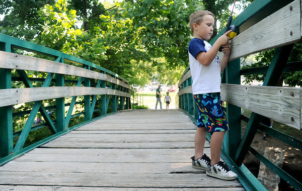 Globe/Roger Nomer<br /> Brandon Hencey, 6, Neosho, casts off a bridge at Morse Park during the kids fishing derby as part of Saturday's Celebrate Neosho.