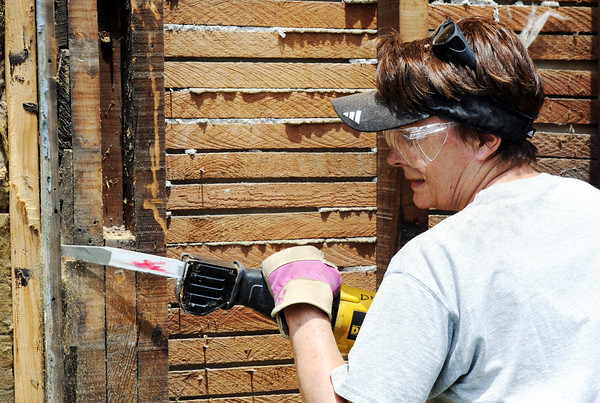 Globe/T. Rob Brown<br /> Judy Lester, of Baton Rouge, La., a volunteer with the Christian Church Disciples of Christ group from Baton Rouge, works on a Rebuild Joplin project in the 2000 block of Pennsylvania Avenue Wednesday afternoon, June 6, 2012.