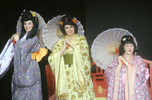 "Globe/Roger Nomer<br /> (from left) Cheyla Navarre, as Yum-Yum, Deborah Stevens, as Peep-Bo, and Olivia Donnel, as Pitti-Sing, rehearse a song from ""The Mikado"" at the Stone's Throw Theatre."