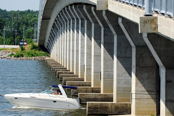 Globe/T. Rob Brown<br /> Boaters travel under the Sailboat Bridge at Grand Lake, Okla., Tuesday afternoon, June 5, 2012.