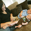 Globe/Roger Nomer<br /> Brittney Knisley plays with her two sons Knox, 8 months, and Remington Harpole, 2.