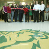 Globe/Roger Nomer<br /> Bob Harrington, director of the physical plant at Missouri Southern, and Bruce Speck, MSSU president, center, cut the ribbon to open Hearnes Hall after a major renovation on Tuesday afternoon.  The renovation includes a new entry way featuring a lion head on the terrazzo floor.