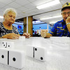 Globe/T. Rob Brown Roxanna Bruckner, left, and Jim Peck, both of Joplin, plan their next play during a game of dominoes Monday afternoon, June 25, 2012, at the Joplin Senior Center, 22nd Street and Jackson Avenue. The center is extending afternoon hours as a cooling location to give seniors an air-conditioned location during peak heat hours.
