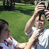 Globe/Roger Nomer<br /> Sydney Ward, a senior broadcasting major at PSU, works as a production assistant with Chris Fogel as they set up a microphone on the PSU campus oval on Wednesday.