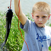 Globe/T. Rob Brown<br /> Daeden Booth, 12, of Alba, holds up a catfish he caught during the annual Kids Fishing Day Saturday morning, June 9, 2012, at Kellogg Lake in Carthage.
