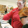 Globe/Roger Nomer<br /> Janae Schoonover, Missouri Southern senior, left, and Jaynya Lioubinskaia, junior, filter a solution during their Allied Sciences and Health class on Thursday at MSSU.