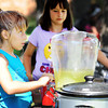 "Globe/T. Rob Brown<br /> Young entrepreneurs Austyn Mickey, left, and Brenlee Adamson, both 8 and of Carl Junction, sell lemonade, doing business as A&B Lemonade Stand, to golfers Friday afternoon, June 8, 2012, off the fourth hole at Briarbrook Golf Course and Country Club. ""This is their first time,"" said Dennis Adamson, Brenlee's father. ""They're learning sales and about being entrepreneurs. It was their idea. They're learning there's more to a business than just selling a product. They had to make an initial investment of time and money. They're having fun too."""
