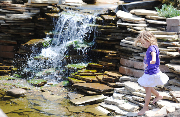Globe/T. Rob Brown Four-year-old Arianna Shafer, of Joplin, plays near a waterfall Wednesday afternoon, June 20, 2012, at Cunningham Park in Joplin.