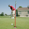 Globe/Roger Nomer<br /> Brent Barron, Webb City, practices his short game at Schifferdecker Golf Course on Friday afternoon.  The course celebrated its 90th birthday on Friday with 90 cent green fees and various golf contests.
