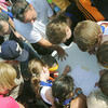 Globe/Roger Nomer<br /> Parents and youth gather to check times from the Big Time Youth Triathlon on Saturday.