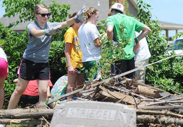 Globe/T. Rob Brown<br /> Molly Brown, 17, of Kingwood, Texas, with a group of SHINE (Serving Him In the Needy & Elderly) youth from Texas, volunteers to help clean up the cemetery behind the location of St. Mary's Catholic School Tuesday afternoon, June 12, 2012. The cemetery still contained debris from the May 22, 2011, tornado.
