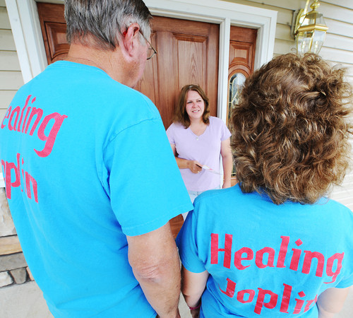 Globe/T. Rob Brown Diane Huddleston, center, of Joplin, speaks with community crisis workers Teri Nunnally and Tom Tiegreen, left, Wednesday afternoon, June 13, 2012, at her front door.
