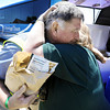 Globe/T. Rob Brown<br /> Jim Groff, of the Christiana, Pa., Lions Club, hugs Nancy Gauthier, of the Parksburg, Pa., Lions Club after she delivers his lunch Friday afternoon, June 8, 2012. Groff, who has made several Joplin recovery trips, is part of a Pennsylvania Lions Club group helping a Duquesne resident repair his home.