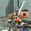 Globe/Roger Nomer<br /> Construction workers transport a slab for the foundation wall of the new Mercy Hospital on Friday.