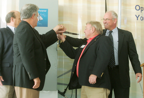 Globe/Roger Nomer<br /> (from left) Joplin Area Chamber of Commerce President Rob O'Brian, Missouri State Senator Ron Richard, Joplin Mayor Pro Tem Bill Scearce and Eagle Picher Technologies President Randy Moore throw the switch for the Power Pyramid on Friday.