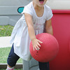 Globe/T. Rob Brown Delilah Harris, 2, shows her enthusiasm for playing ball Tuesday afternoon, June 19, 2012, at the Learning Junction Educational Center in Joplin.