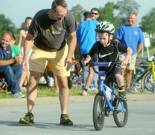 Globe/Roger Nomer<br /> Joe Fiorino gives his son Dawson, 6, some last minute advice as he starts the cycling leg of the Big Time Youth Triathlon on Saturday.