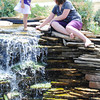 Globe/T. Rob Brown Four-year-old Arianna Shafer, and friend Katie Woehlke, 10, both of Joplin, play near a waterfall Wednesday afternoon, June 20, 2012, at Cunningham Park in Joplin.