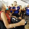 "Globe/T. Rob Brown Robin Creemer, left, of Joplin, who has suffered with M.S. for 39 years, speaks to Alex Solomon, of Cobden, Ill., as he and other cyclists eat lunch Tuesday afternoon, June 26, 2012, at Wheat State Pizza in Pittsburg, Kan. Creemer said she was diagnosed with M.S. when she was 21 and she was one of the 11,500 Winter Olympics 2002 torch carriers when she carried the torch under the St. Louis Arch. She said she likes to come out to show her support and to encourage the cyclists. ""Their being here gives us hope that there's people out here fighting for us,"" Creemer said. ""Hopefully soon, M.S. will be no more."""